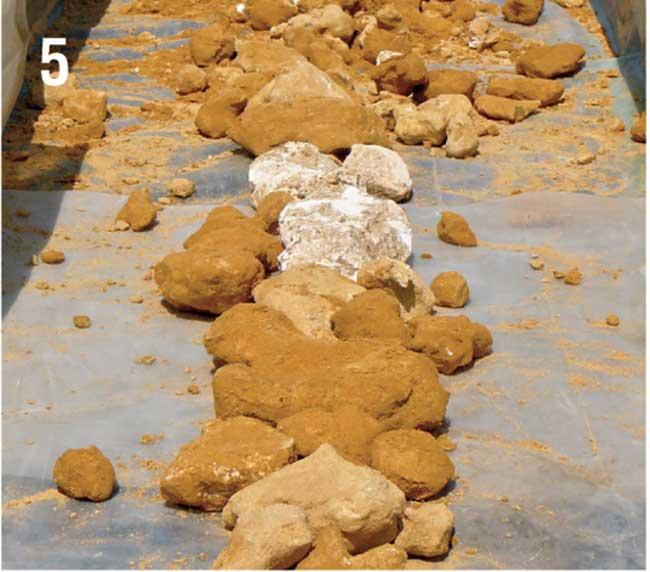 applicazione di pietre per drenaggio orto